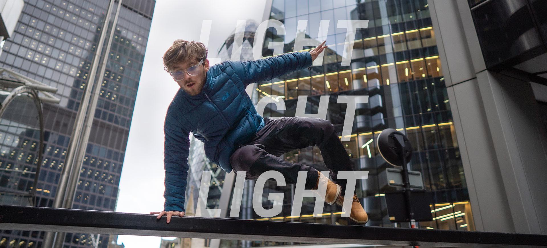 Man jumps over barrier